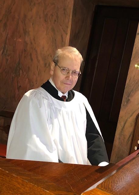David Ralph sitting at organ